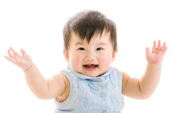 Asian baby girl hand up Stock Images