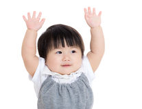 Asian baby girl hand up. Isolated on white Royalty Free Stock Image