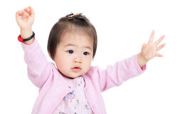 Asian baby girl hands up royalty free stock images
