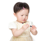 Asian baby girl holding crayon. Isolated on white Stock Photography