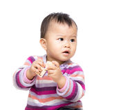 Asian baby girl holding toy block Royalty Free Stock Images
