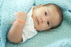 Asian baby girl laying on bed Stock Images