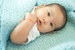Asian baby girl laying on bed Royalty Free Stock Photography