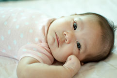 Asian baby girl laying on bed Royalty Free Stock Photo