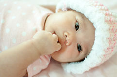 Asian baby girl laying on bed. And smiling Royalty Free Stock Photo