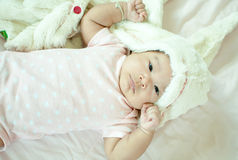 Asian baby girl laying on bed Stock Photos
