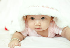 Asian baby girl laying on bed. And smiling Stock Image