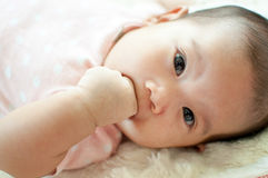 Asian baby girl laying on bed. And smiling Stock Photos