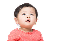 Asian baby girl looking up Stock Photo