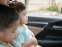 Asian baby girl on a the trip to school with her mother and sister during the morning rush hours royalty free stock photography