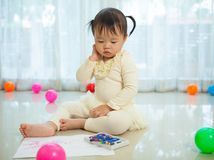 Asian baby girl painting Royalty Free Stock Photo