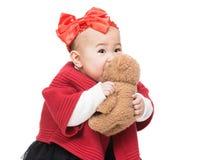 Asian baby girl play doll bear Stock Photo