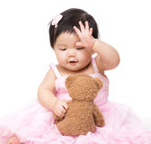 Asian baby girl play with doll Royalty Free Stock Photo