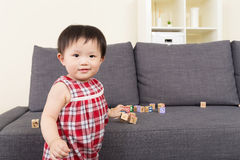 Asian baby girl play with wooden block Royalty Free Stock Photos