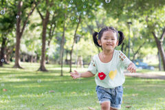 Asian baby girl playing bubble balloon Royalty Free Stock Image