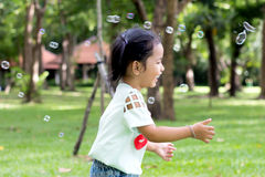 Asian baby girl playing bubble balloon. Cute Asian baby girl playing bubble balloon Royalty Free Stock Photo