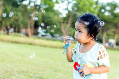 Asian baby girl playing bubble balloon Royalty Free Stock Photography