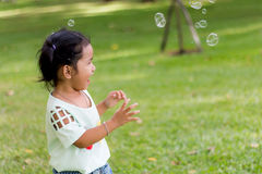 Asian baby girl playing bubble balloon Stock Images