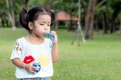 Asian baby girl playing bubble balloon. Cute Asian baby girl playing bubble balloon Stock Photography