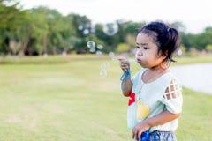 Asian baby girl playing bubble balloon. Cute Asian baby girl playing bubble balloon Royalty Free Stock Image
