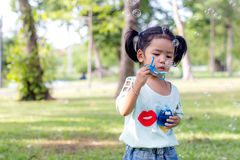 Asian baby girl playing bubble balloon Royalty Free Stock Photo
