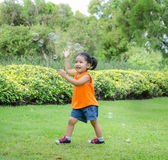 Asian baby girl playing bubble. In garden Royalty Free Stock Photo