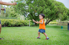 Asian baby girl playing bubble Royalty Free Stock Photos