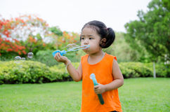 Asian baby girl playing bubble. In garden Royalty Free Stock Photos