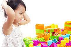 Asian Baby Girl Playing Colorful Blocks  on White Background. Stock Photos