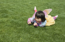 Asian baby girl playing on the grass Stock Photos