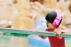 Asian baby girl playing in swimming pool Royalty Free Stock Images