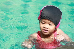 Asian baby girl playing in swimming pool Stock Image