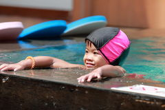 Asian baby girl playing in swimming pool Royalty Free Stock Photos
