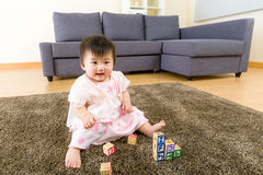 Asian baby girl playing toy block Royalty Free Stock Images