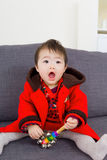 Asian baby girl playing toy Royalty Free Stock Photos