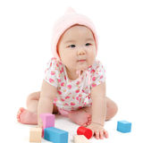 Asian baby girl playing wood blocks Royalty Free Stock Photo
