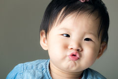 Asian baby girl purse lip Royalty Free Stock Photos