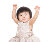Asian baby girl raise up both hand. Isolated on white Royalty Free Stock Photography
