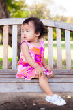 Asian baby girl sitting and look back Stock Photography