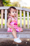 Asian baby girl sitting and looking forward Stock Photo