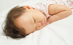 Asian baby girl sleeping on bed Royalty Free Stock Image