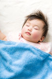 Asian baby girl sleeping Royalty Free Stock Photos