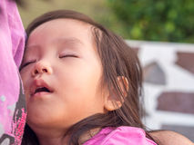 Asian baby girl sleeping. With her mother Royalty Free Stock Photography