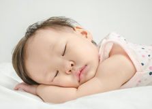 Asian baby girl sleeping Royalty Free Stock Photography
