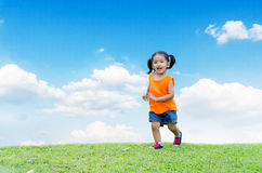 Asian baby girl smile and running. In the garden Royalty Free Stock Images