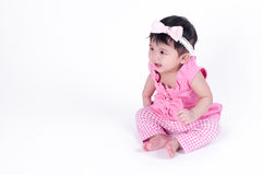 Asian baby girl is smiling and laughing on white background Stock Image