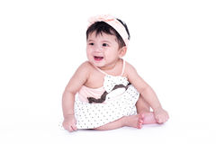 Asian baby girl is smiling and laughing on a white background Royalty Free Stock Image