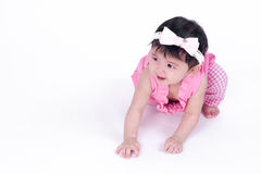 Asian baby girl is smiling and laughing on white background Royalty Free Stock Image