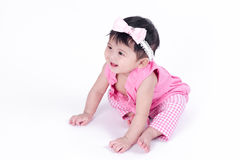 Asian baby girl is smiling and laughing on white background Royalty Free Stock Photos