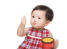 Asian baby girl with snack box and thumb up. Isolated on white Stock Image